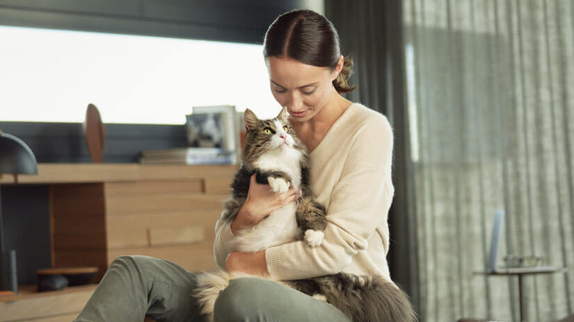 Woman holding cat on her lap